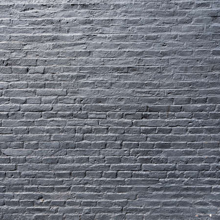 square part of silver gray painted brick wall