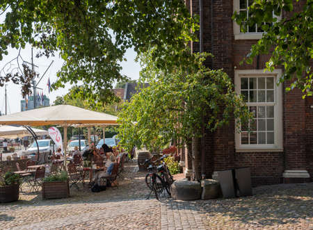 Leer, Germany, 26 august 2019: former weighing house is now outdoor cafe near museum harbor in german town of Leer in lower saxony