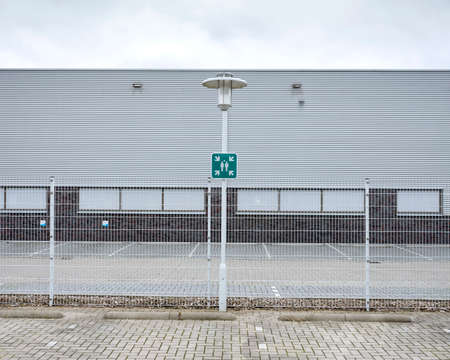 green meeting point sign in industrial environment on places where you would not expect it