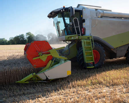 combine working on grain field during harvest in the north of france Reklamní fotografie