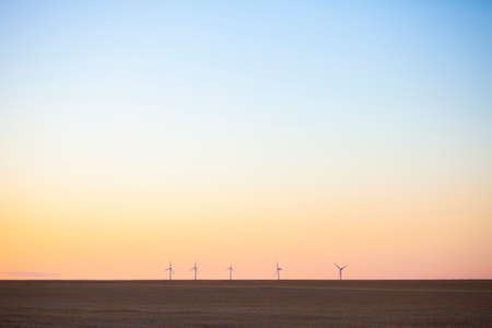wind turbines behind empty fields in the north of france during sunset Reklamní fotografie