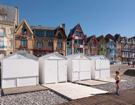 beach cabins and colorful houses of mers les bains in french normandy