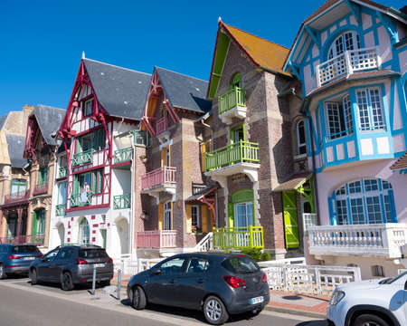 boulevard with cars and colorful houses of mers les bains in french normandy