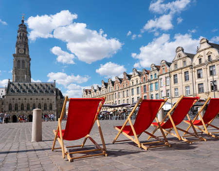 red chairs on grand place near belfry tower in arras Redakční