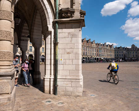 people and bicycle on grand place near belfry tower in arras Redakční