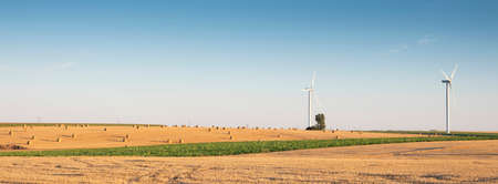 fields after harvest in the north of france with wind turbines in the background Reklamní fotografie