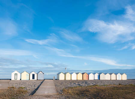 beach huts in cayeux s mer in french normandy under blue sky Reklamní fotografie