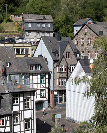 tourist on street of old city monschau in german eifel