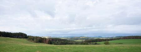 meadows and forest in rural landscpae of german eifel in summer