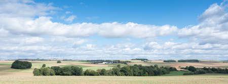 farm and fields on high plane neer Cochem in german voreifel and wind turbines