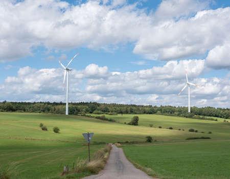 countryside of german eifel with road and wind turbines Reklamní fotografie