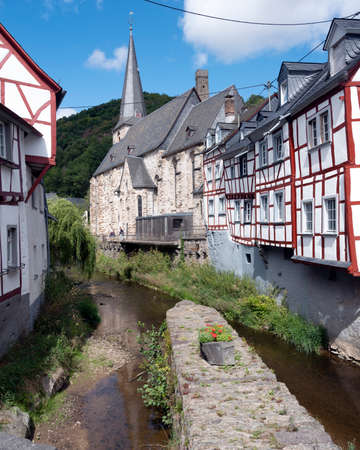 river and half timbered houses in beautiful village of Monreal in german eifel