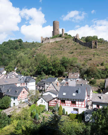 half timbered houses and castle ruin in beautiful village of Monreal in german eifel