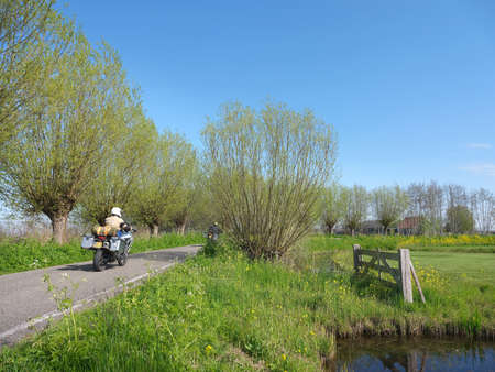 motorcycles on country road near worden in holland on spring day Reklamní fotografie