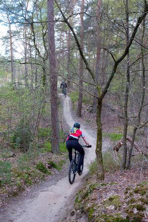 man on mountain bike in spring forest near utrecht in holland