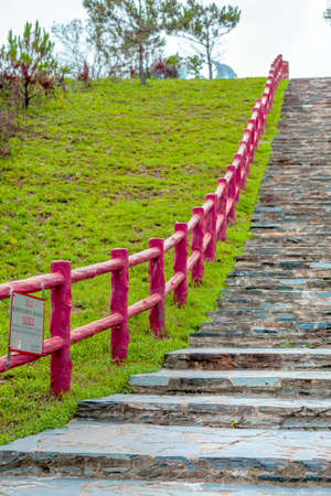 fench: Walking Path in countryside with red wooden fench