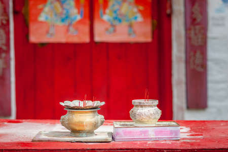 temple burn: Incense in old traditional chinese temple Stock Photo