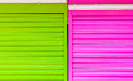 parallels: Close up of a colorcul metal gate, nobody