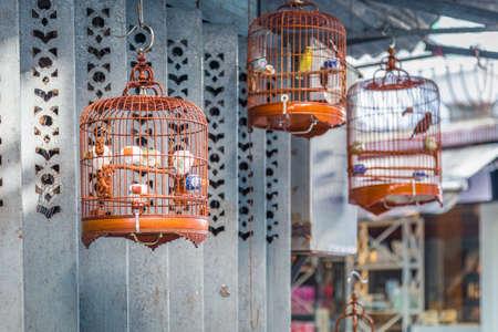 Bird cage hanging on streets, Hong Kong
