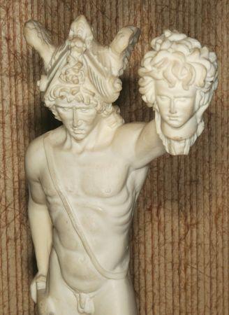 Detail dune enacts Persee holding Medusas head