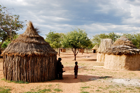 poverty: Himba village with traditional huts near Etosha National Park in Namibia, Africa