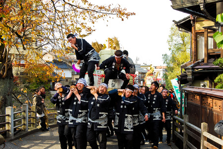 japanese people: Young people celebrating a sake festival in the old town of Hida Takayama, Japan Editorial