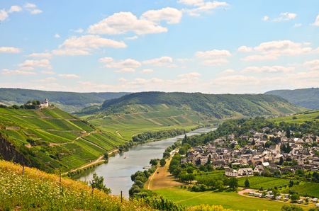 green river: View to river Moselle and Marienburg Castle near village Puenderich - Mosel wine region in Germany