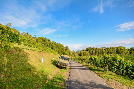 wine road: Vineyards with old car at the South Styrian Wine Road in autumn, Austria Europe Stock Photo