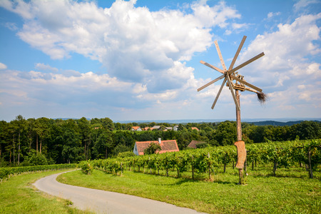 wine road: Vineyards and Klapotetz pinwheel at the South Styrian Wine Road in autumn, Austria Europe