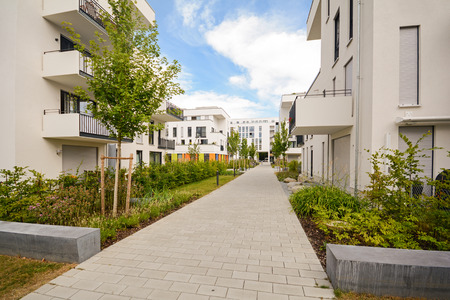 Modern residential buildings with outdoor facilities, Facade of new apartment houses Standard-Bild