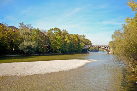 Riverside with bridge across the Isar River in Munich, Bavaria Germany Europe Stock Photo