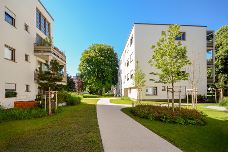 Modern residential buildings in a green environment, sustainable urban planning