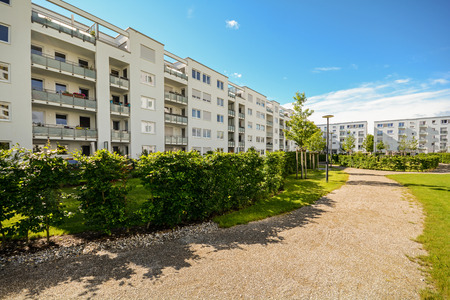 apartment blocks: Apartment building in the city - Facade of new modern residential houses with low energy standard