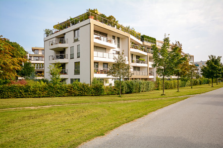 Modern green residential building, apartments in a new urban development Redactioneel