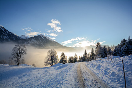 Winter landscape with icy road in the Austrian Alps near Salzburg in Austria, Europe