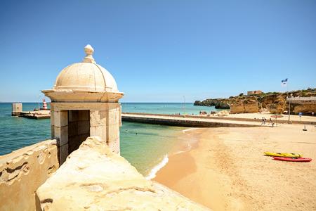 View from fortress Forte da Ponta da Bandeira in Lagos to waterfront with beach Praia da Batata, Algarve Portugal Stock Photo