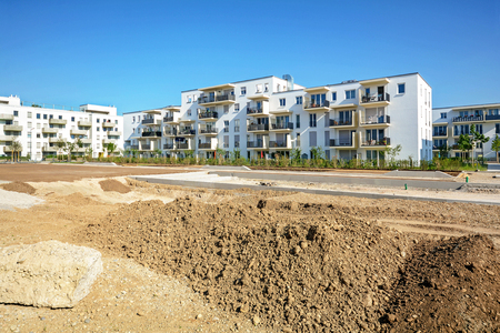 Urban development with construction site and new residential buildings Stok Fotoğraf
