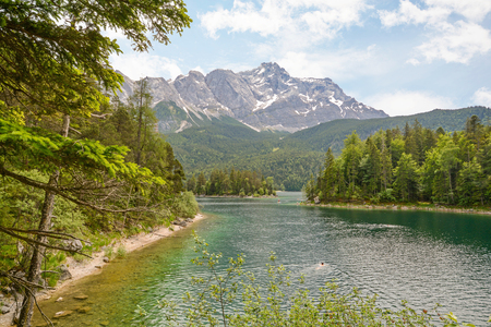 View to lake Eibsee and Zugspitze, Germany`s highest mountain in the bavarian alps, Bavaria Germany Stok Fotoğraf