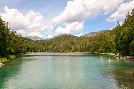 Stand up paddling at lake Eibsee in the bavarian alps near Garmisch Partenkirchen, Bavaria Germany