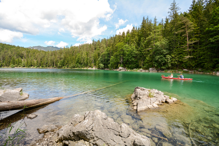 Canoeing at lake Eibsee in the bavarian alps near Garmisch Partenkirchen, Bavaria Germany Stok Fotoğraf