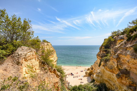 Algarve Portugal: Huge rocks at the cliff beach Praia da Marinha, lovely hidden beach near Lagoa