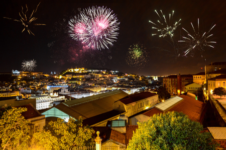 Lisbon at night with fireworks: View from Miradouro Bairro Alto to the castle Castelo de San Jorge and Alfama district, Portugal Editöryel