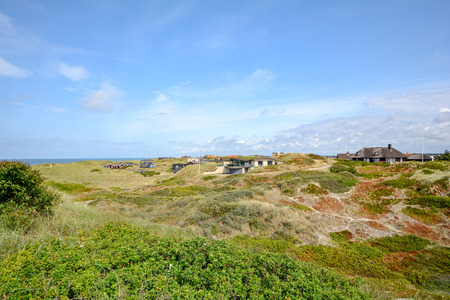Dune landscape at the North Sea with holiday homes near Henne Strand, Jutland Denmark Scandinavia