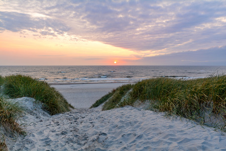 Sunset at beautiful beach with sand dune landscape near Henne Strand, Jutland Denmark