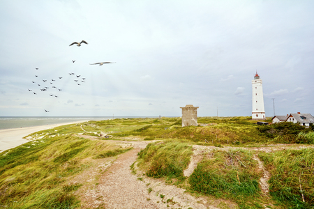 Lighthouse and bunker in the sand dunes on the beach of Blavand, Jutland Denmark Europe Stok Fotoğraf