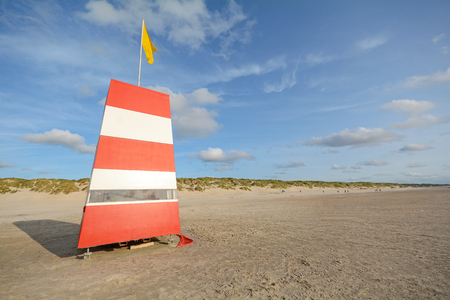 Red-white lifeguard tower on the beach of Henne Strand, Jutland Denmark Europe