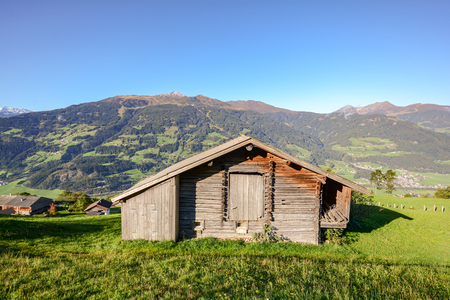 Alpine pasture hike to an old wooden barn with mountain meadow in the austrian alps, Zillertal Austria Stok Fotoğraf