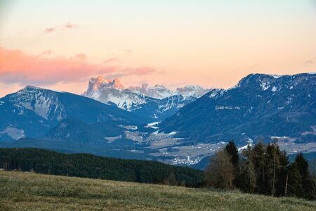 View from Ritten high plateau to mountain range of dolomites alps in South Tyrol, Italy Stok Fotoğraf