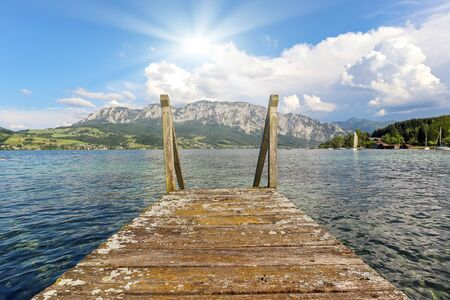 View to lake Attersee with sailing boat, Mountains of austrian alps near Salzburg, Austria Europe Stok Fotoğraf - 129320481