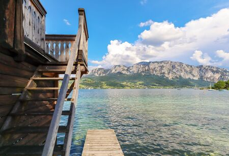View to lake Attersee with sailing boat, Mountains of austrian alps near Salzburg, Austria Europe Stok Fotoğraf - 129320479